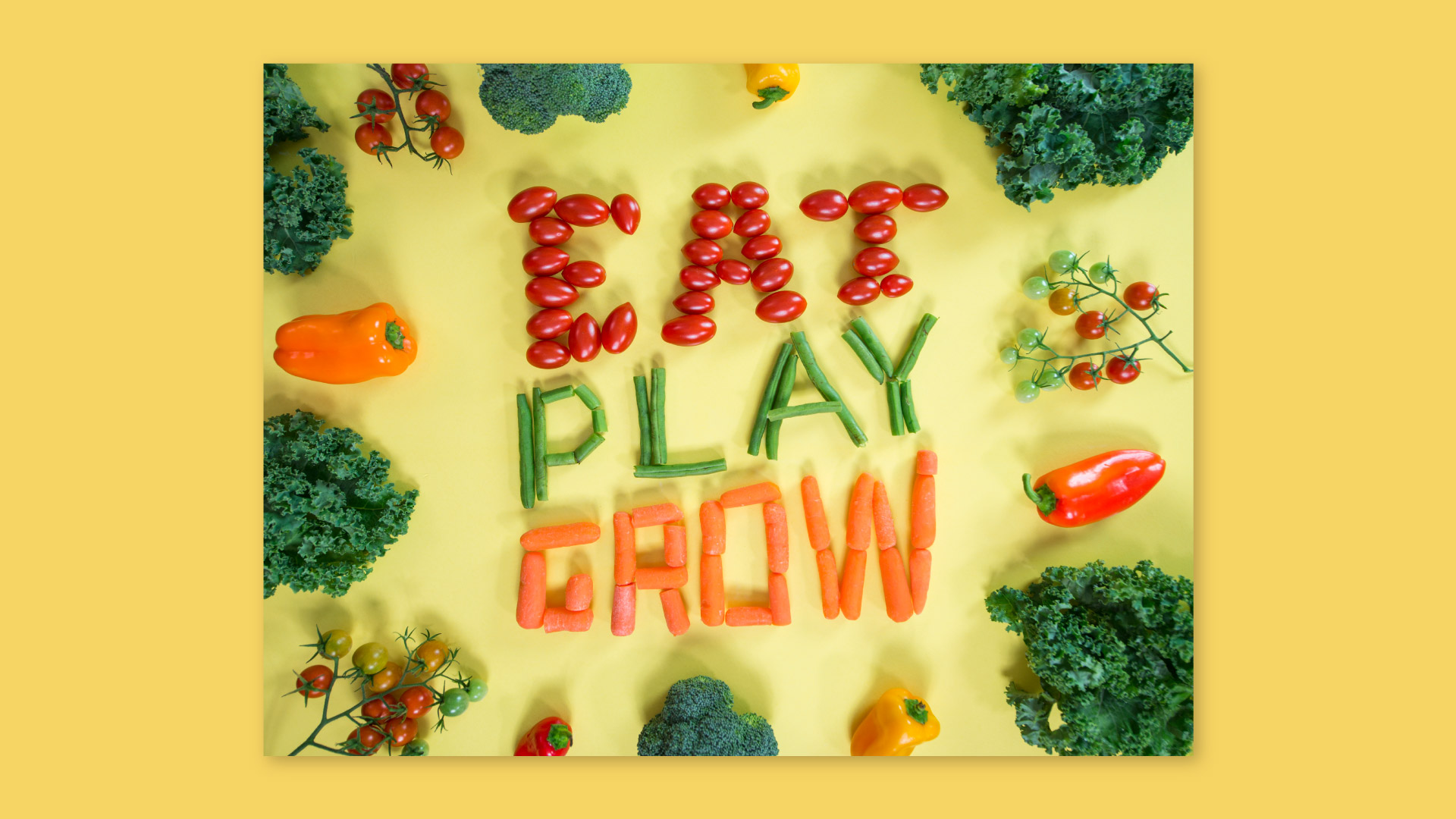 Eat play grow spelled with carrots, tomatoes and green beans
